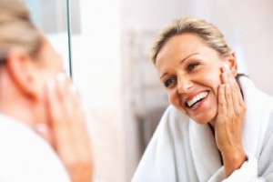 mature woman looking in the mirror
